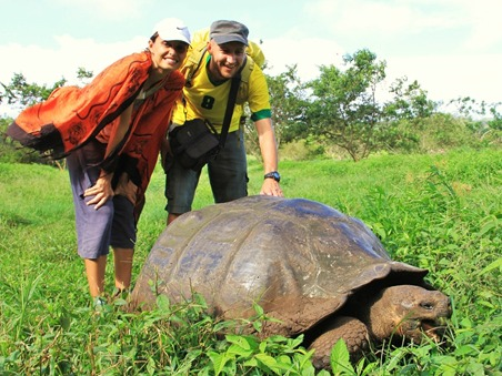 With a Galapagos giant tortoise.
