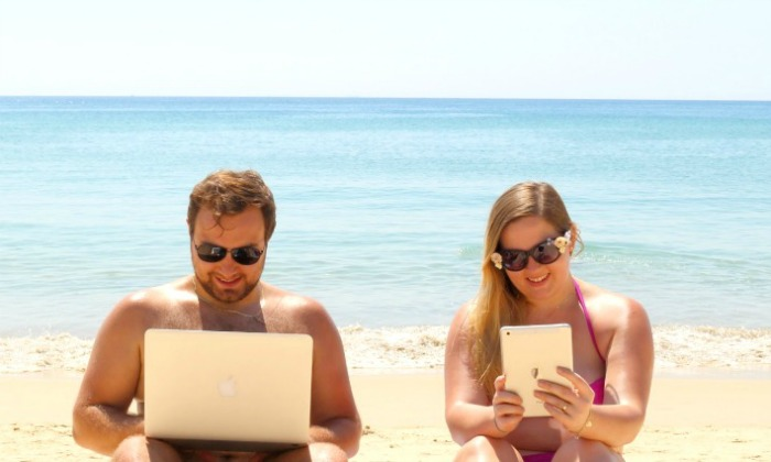 Karolina and Patryk working on their online business on the beach